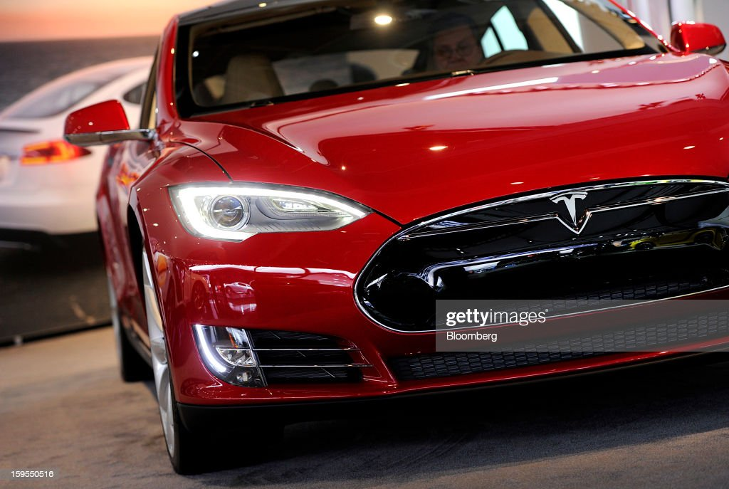A Tesla Motors Inc. vehicle is displayed during the 2013 North American International Auto Show (NAIAS) in Detroit, Michigan, U.S., on Tuesday, Jan. 15, 2013. The Detroit auto show runs through Jan. 27 and will display over 500 vehicles, representing the most innovative designs in the world. Photographer: David Paul Morris/Bloomberg via Getty Images