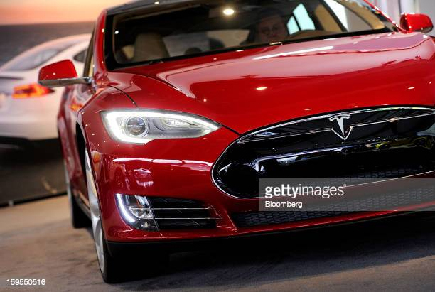 A Tesla Motors Inc vehicle is displayed during the 2013 North American International Auto Show in Detroit Michigan US on Tuesday Jan 15 2013 The...