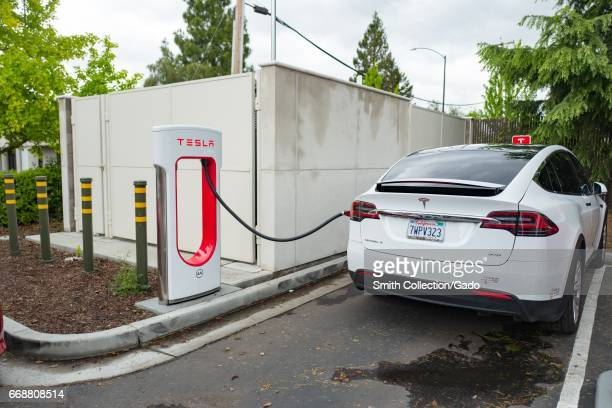 A Tesla Motors Model X SUV is charging at a supercharger station in the Silicon Valley town of Mountain View California April 7 2017