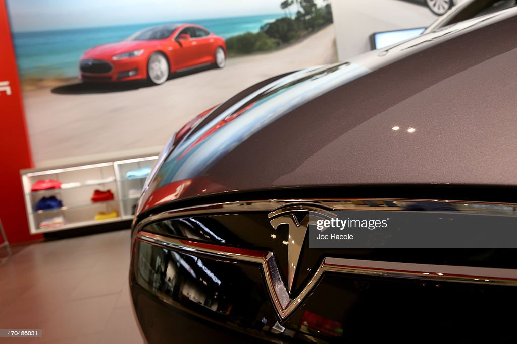 A Tesla Motors vehicle is seen on the showroom floor at the Dadeland Mall on February 19, 2014 in Miami, Florida. Tesla said today it earned $46 million in the fourth quarter on a non-adjusted basis, or 33 cents a share and their shares jumped 12%.
