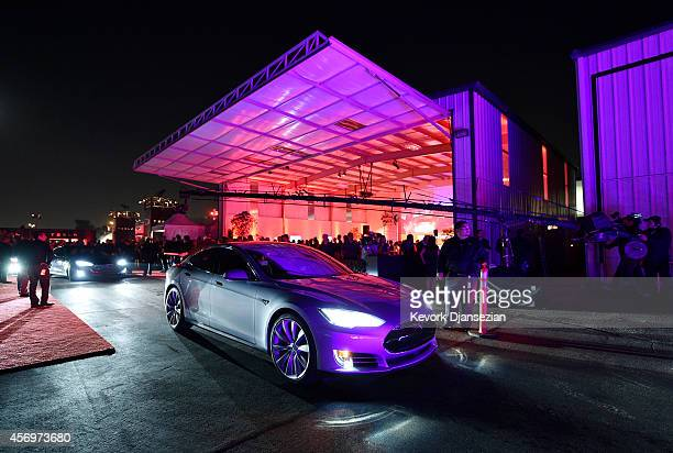 Tesla owners take a ride in the new Tesla 'D' model electric sedan after Elon Musk CEO of Tesla unveiled the dual engine chassis of the new Tesla 'D'...