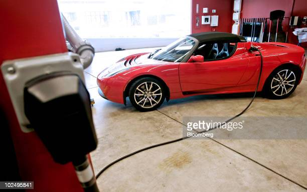 Tesla Roadster electric car is charged in the service area of the Tesla dealership in Los Angeles California US on Saturday June 26 2010 Tesla Motors...
