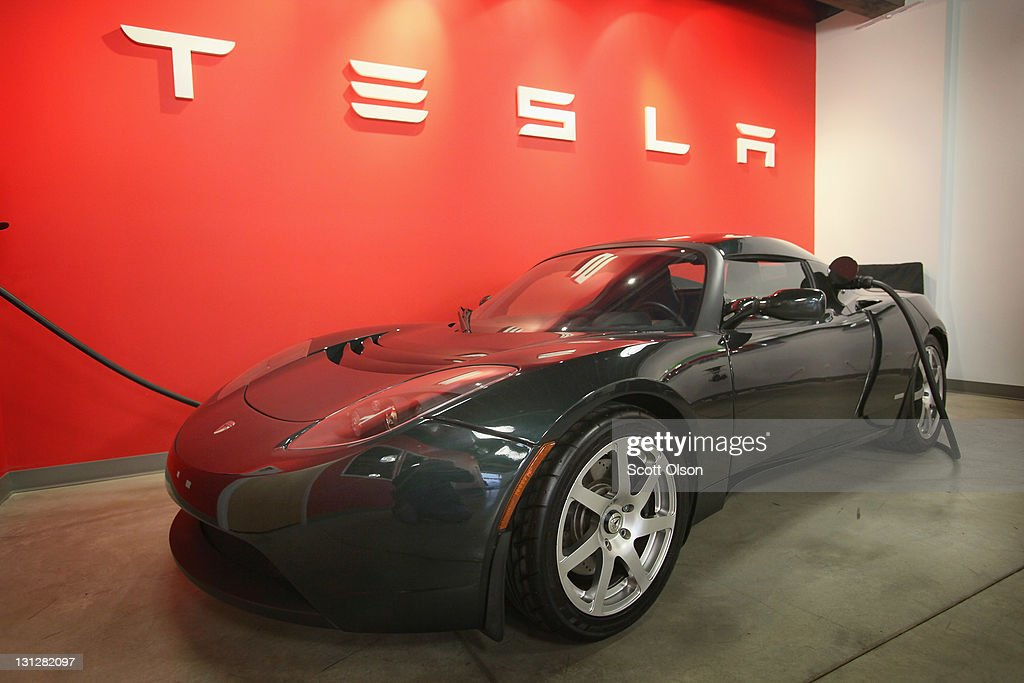 A Tesla Roadster Sport sits in a dealership showroom on November 3, 2011 in Chicago, Illinois. Tesla Motors Inc. stock rose more than 13 percent today after the electric sports car maker reported a less-than-expected third quarter loss. Tesla has already sold out of next year's production of the Model S sedan, the company's first four-door vehicle.
