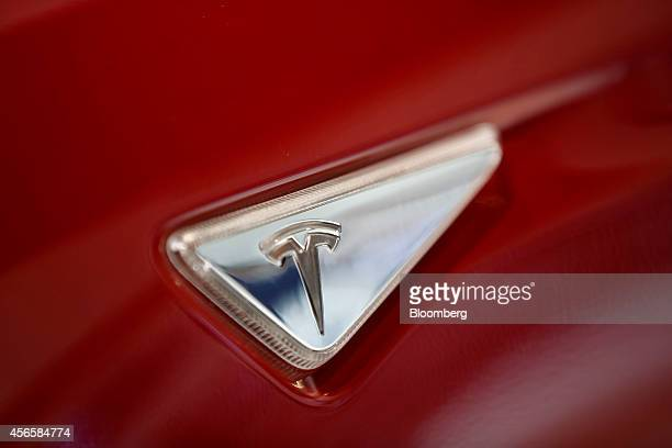 A Tesla T logo sits on the panel of a Tesla Model S automobile produced by Tesla Motors Inc at the Paris Motor Show on the final preview day in Paris...