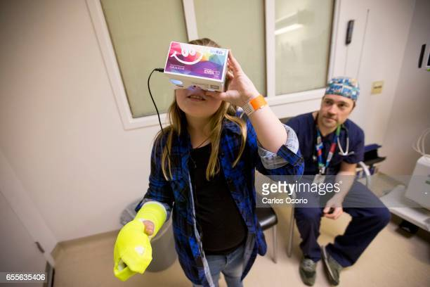 TORONTO ON FEBRUARY Tess Baird uses the VR headset while Dr Ben O'Sullivan looks on Virtual Reality isn't just for gamers A new project between...
