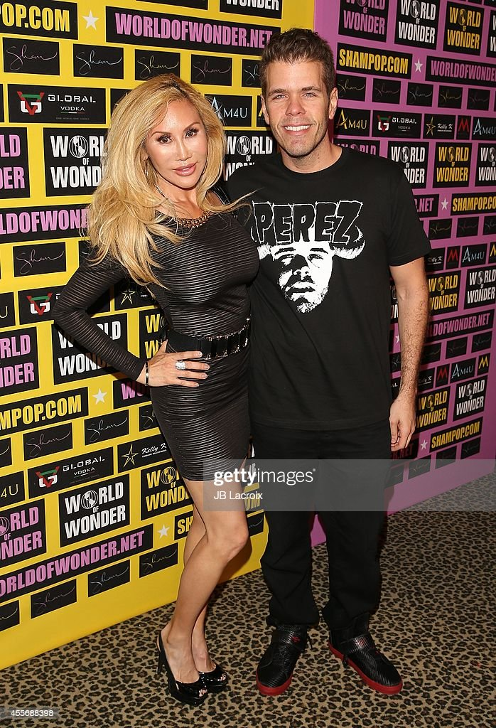 Tess Broussard and Perez Hilton attend a private art exhibition of Hollywood's favorite Pop Culture artist Sham Ibrahim on September 18 in Hollywood...