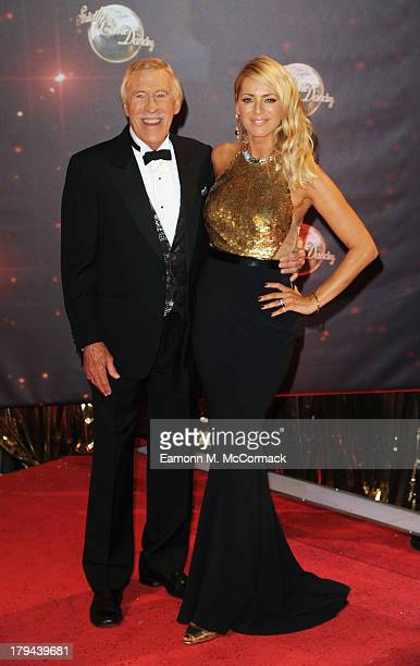 Tess Daly and Bruce Forsyth attend the red carpet launch for 'Strictly Come Dancing' at Elstree Studios on September 3 2013 in Borehamwood England