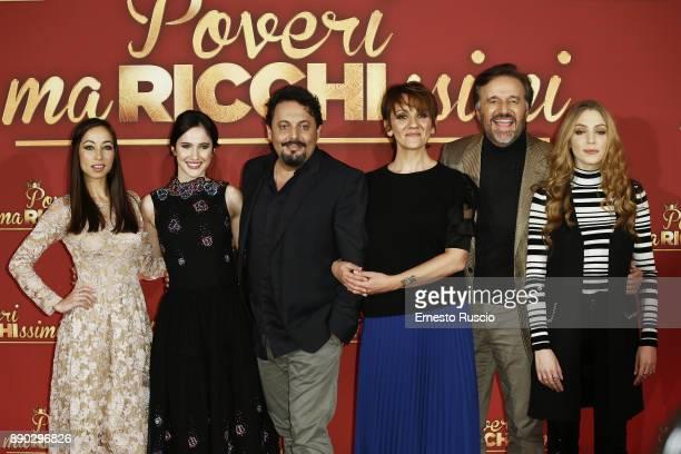 Tess Masazza Lodovica Comello Enrico Brignano Lucia Ocon Christia De Sica and Federica Lucaferri attend 'Poveri Ma Ricchissimi' photocall on December...