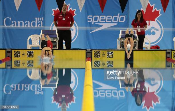 TORONTO ON OCTOBER 3 Tess Routliffe and Justine Morrier of Canada start the 100 metres breaststroke as the Paraswimming athletes compete in the...