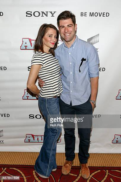 Tess Sanchez and Max Greenfield pose for a photo at an event where Max Greenfield and daughter Lilly Greenfield host a screening of ANNIE for friends...