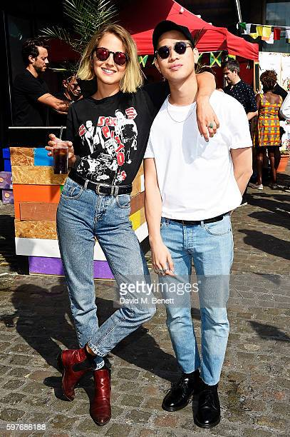 Tess Ward and a guest attend the Converse party at Notting Hill Carnival to celebrate the new carnival inspired Converse Custom Chuck Taylor All...