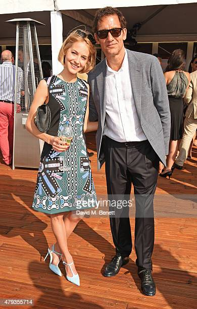 Tess Ward and Clive Owen attend the Audi Polo Challenge 2015 at Cambridge County Polo Club on July 3 2015 in Cambridge England