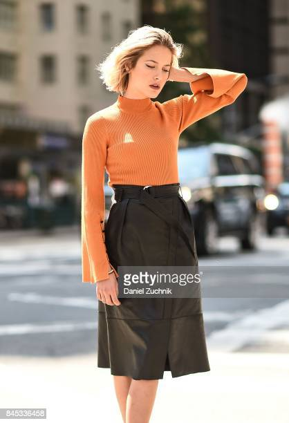 Tess Ward at New York Fashion Week wearing a Karen Millen sweater and skirt on September 10 2017 in New York City