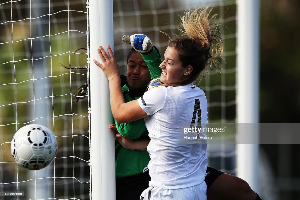 Tessa Berger of New Zealand clashes with Vaelua Fautua of Samoa for the ball during the OFC U20 Women's Championship match between Samoa and New Zealand at Centre Park on April 14, 2012 in Auckland, New Zealand.