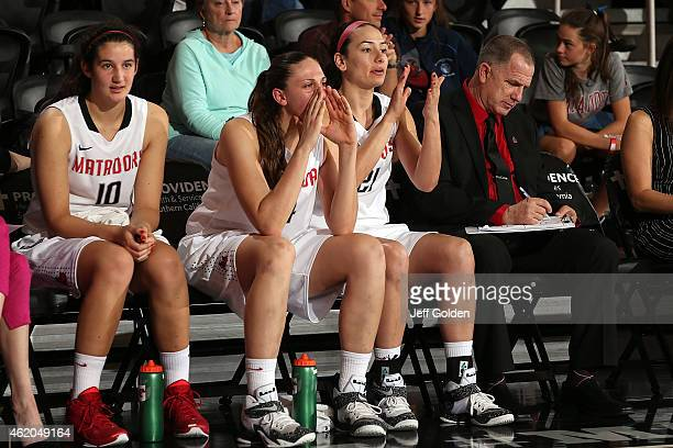 Tessa Boagni Camille Mahlknecht Travis Newman and director of operations Thomas Osburn of the CSUN Matadors look on from the bench against the UC...