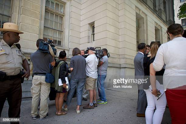 Tessa HillAston President of the Baltimore NAACP and attorney Warren Brown address the media outside the Circuit Court on the first day in the trial...