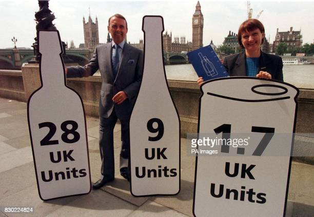 Tessa Jowell MP minister for Public Health and Kneale Ashwell chairman of Seagram Distillers pose in London with replicas of the icons that will...
