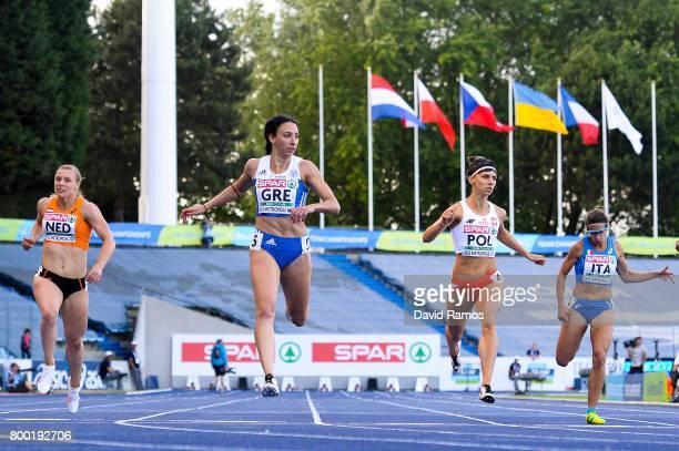 Tessa van Schagen of Netherlands Maria Belibasaki of Greece Anna Kielbasinska of Poland and Irene Siragusa of Italy compete in the Women's 200m heat...