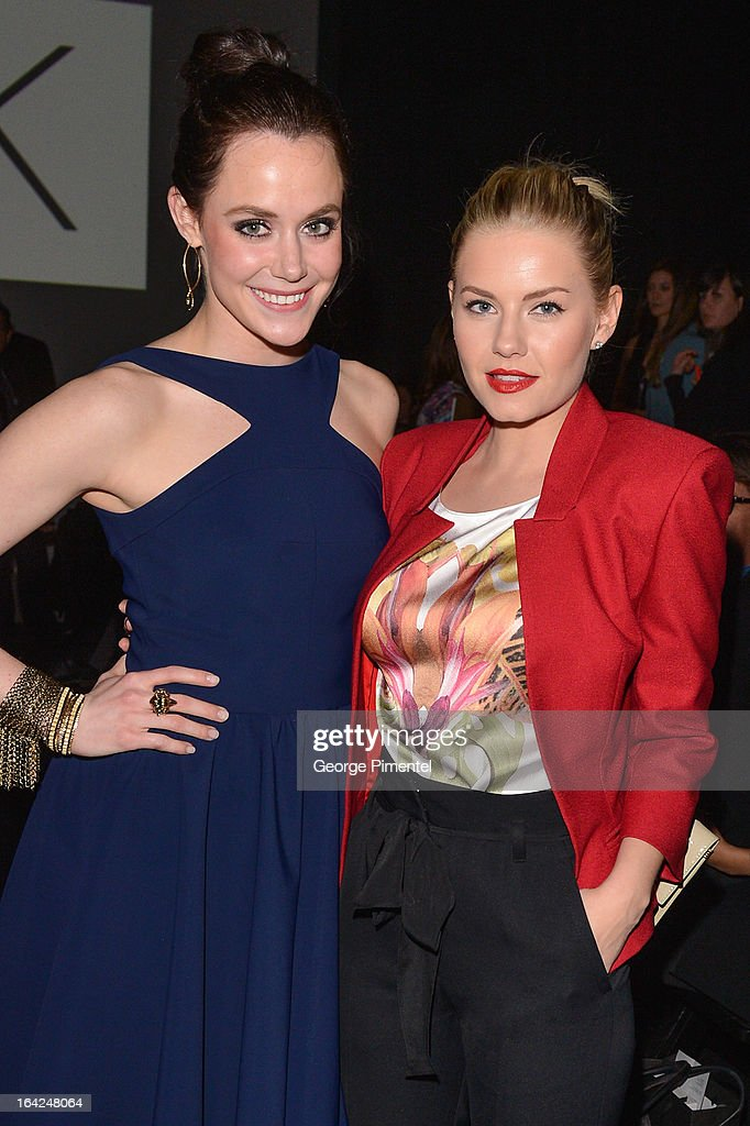 Tessa Virtue and actress Elisah Cuthbert attend World MasterCard Fashion Week Fall 2013 at David Pecaut Square on March 21, 2013 in Toronto, Canada.