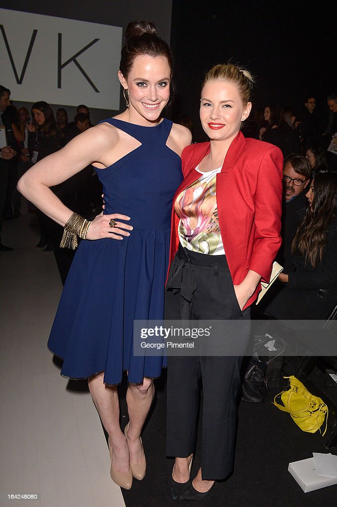 <a gi-track='captionPersonalityLinkClicked' href=/galleries/search?phrase=Tessa+Virtue&family=editorial&specificpeople=793314 ng-click='$event.stopPropagation()'>Tessa Virtue</a> and actress Elisah Cuthbert attend World MasterCard Fashion Week Fall 2013 at David Pecaut Square on March 21, 2013 in Toronto, Canada.