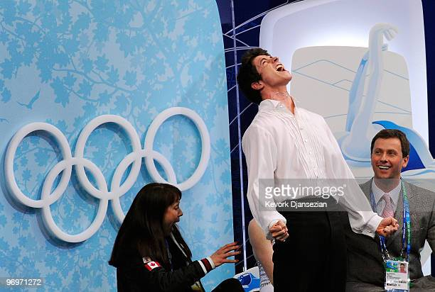Tessa Virtue and Scott Moir of Canada celebrate after receiving their scores for the free dance portion of the Ice Dance competition on day 11 of the...