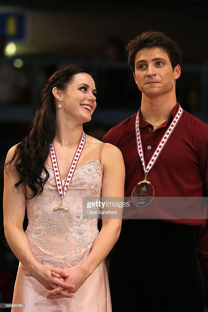 Tessa Virtue (L) and Scott Moir of Canada celebrate their gold medal win in the ice dance free program on day two at the ISU GP 2013 Skate Canada International at Harbour Station on October 26, 2013 in Saint John, New Brunswick, Canada.
