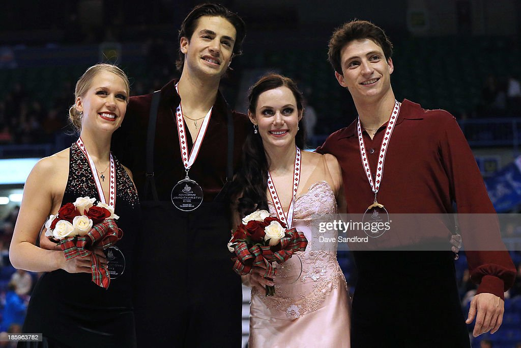 Tessa Virtue (2R) and Scott Moir of Canada (R) celebrate their gold medal win along side silver medalists Kaitlyn Weaver (L) and Andrew Poje of Canada in the ice dance free program on day two at the ISU GP 2013 Skate Canada International at Harbour Station on October 26, 2013 in Saint John, New Brunswick, Canada.