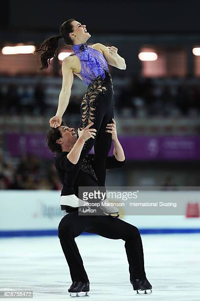 Tessa Virtue and Scott Moir of Canada compete during Senior Ice Dance Short Dance on day two of the ISU Junior and Senior Grand Prix of Figure...