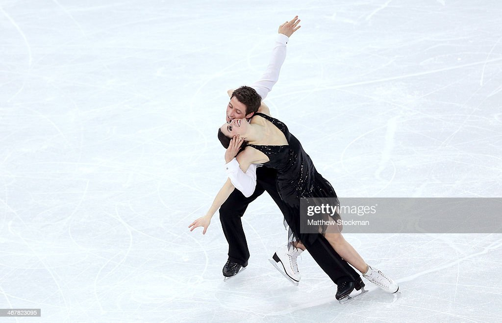 <a gi-track='captionPersonalityLinkClicked' href=/galleries/search?phrase=Tessa+Virtue&family=editorial&specificpeople=793314 ng-click='$event.stopPropagation()'>Tessa Virtue</a> and <a gi-track='captionPersonalityLinkClicked' href=/galleries/search?phrase=Scott+Moir&family=editorial&specificpeople=793313 ng-click='$event.stopPropagation()'>Scott Moir</a> of Canada compete in the Figure Skating Team Ice Dance - Short Dance during day one of the Sochi 2014 Winter Olympics at Iceberg Skating Palace on February 8, 2014 in Sochi, Russia.