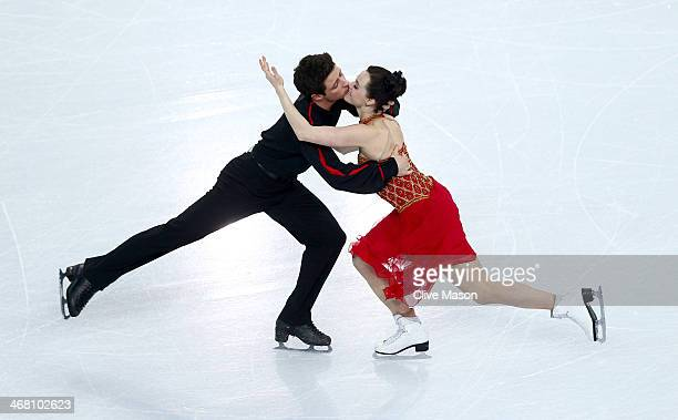 Tessa Virtue and Scott Moir of Canada compete in the Team Ice Dance Free Dance during day two of the Sochi 2014 Winter Olympics at Iceberg Skating...