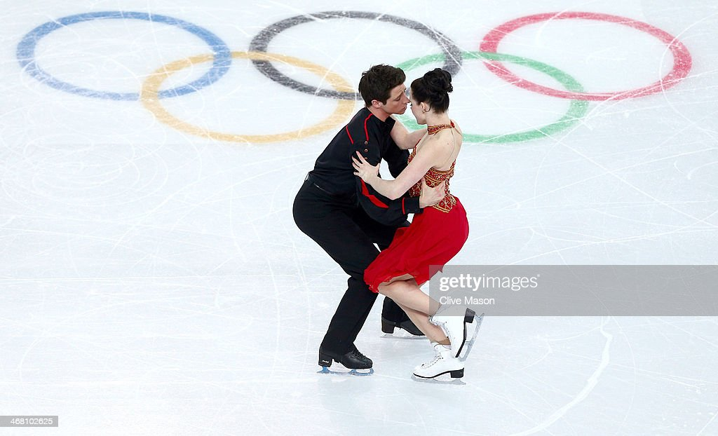 <a gi-track='captionPersonalityLinkClicked' href=/galleries/search?phrase=Tessa+Virtue&family=editorial&specificpeople=793314 ng-click='$event.stopPropagation()'>Tessa Virtue</a> and <a gi-track='captionPersonalityLinkClicked' href=/galleries/search?phrase=Scott+Moir&family=editorial&specificpeople=793313 ng-click='$event.stopPropagation()'>Scott Moir</a> of Canada compete in the Team Ice Dance Free Dance during day two of the Sochi 2014 Winter Olympics at Iceberg Skating Palace onon February 9, 2014 in Sochi, Russia.
