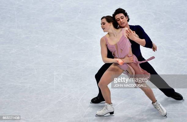 Tessa Virtue and Scott Moir of Canada compete to win the Ice Dance / Free Dance event at the ISU World Figure Skating Championships in Helsinki...