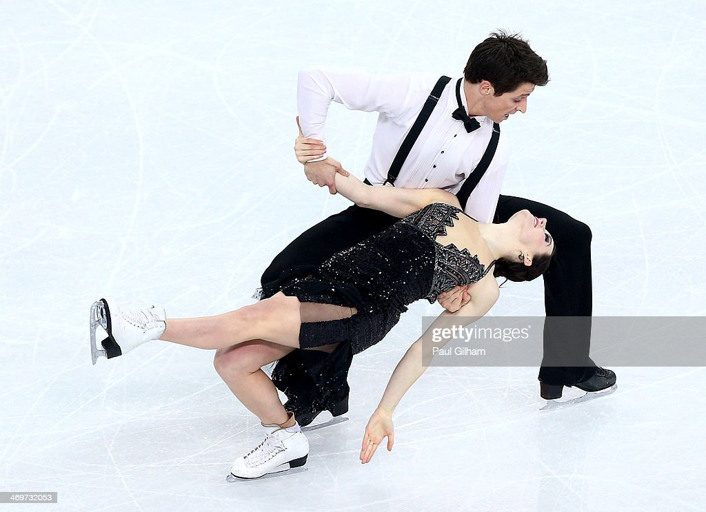 <a gi-track='captionPersonalityLinkClicked' href=/galleries/search?phrase=Tessa+Virtue&family=editorial&specificpeople=793314 ng-click='$event.stopPropagation()'>Tessa Virtue</a> and <a gi-track='captionPersonalityLinkClicked' href=/galleries/search?phrase=Scott+Moir&family=editorial&specificpeople=793313 ng-click='$event.stopPropagation()'>Scott Moir</a> of Canada competes during the Figure Skating Ice Dance Short Dance on day 9 of the Sochi 2014 Winter Olympics at Iceberg Skating Palace on February 16, 2014 in Sochi, Russia.
