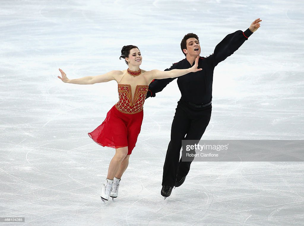 <a gi-track='captionPersonalityLinkClicked' href=/galleries/search?phrase=Tessa+Virtue&family=editorial&specificpeople=793314 ng-click='$event.stopPropagation()'>Tessa Virtue</a> and <a gi-track='captionPersonalityLinkClicked' href=/galleries/search?phrase=Scott+Moir&family=editorial&specificpeople=793313 ng-click='$event.stopPropagation()'>Scott Moir</a> of Canada competes in the Team Ice Dance Free Dance during day 2 of the Sochi 2014 Winter Olympics at Iceberg Skating Palace on February 9, 2014 in Sochi, Russia.