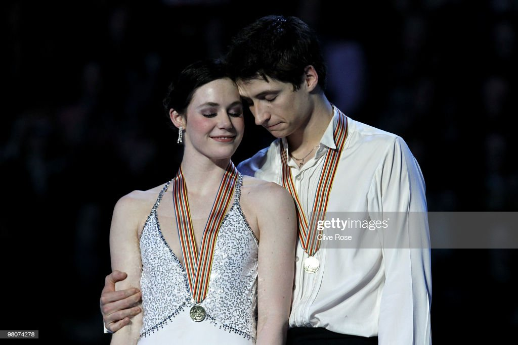 <a gi-track='captionPersonalityLinkClicked' href=/galleries/search?phrase=Tessa+Virtue&family=editorial&specificpeople=793314 ng-click='$event.stopPropagation()'>Tessa Virtue</a> and <a gi-track='captionPersonalityLinkClicked' href=/galleries/search?phrase=Scott+Moir&family=editorial&specificpeople=793313 ng-click='$event.stopPropagation()'>Scott Moir</a> of Canada cuddle on the podium with their Gold medals after the Ice Dance Free Dance during the 2010 ISU World Figure Skating Championships on March 26, 2010 at the Palevela in Turin, Italy.