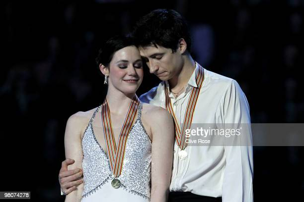 Tessa Virtue and Scott Moir of Canada cuddle on the podium with their Gold medals after the Ice Dance Free Dance during the 2010 ISU World Figure...