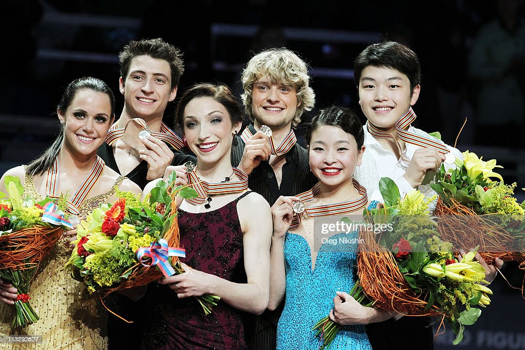Tessa Virtue and Scott Moir of Canada (L), Meryl Davis and Charlie White of USA (C), Maia Shibutani and Alex Shibutani of USA (R) smile on the podium after winning of the ice dance category of the ISU World Figure Skating Championships at Megasport Ice Rink on April 30, 2011 in Moscow, Russia.