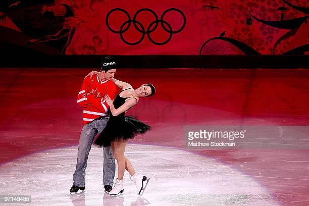 Tessa Virtue and Scott Moir of Canada perform at the Exhibition Gala following the Olympic figure skating competition at Pacific Coliseum on February...