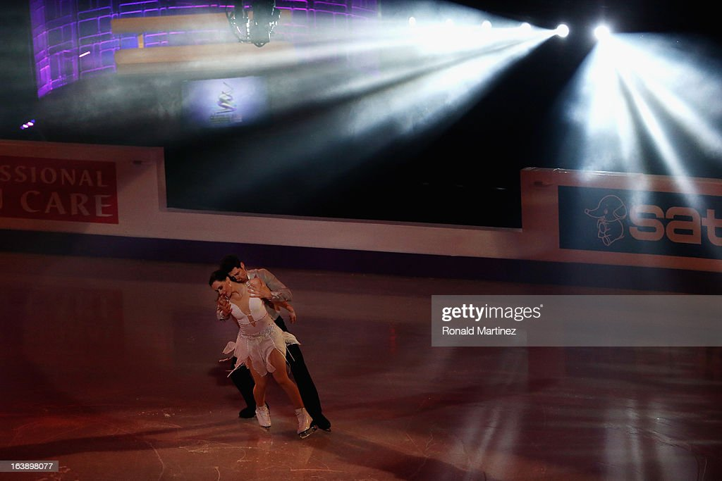 <a gi-track='captionPersonalityLinkClicked' href=/galleries/search?phrase=Tessa+Virtue&family=editorial&specificpeople=793314 ng-click='$event.stopPropagation()'>Tessa Virtue</a> and <a gi-track='captionPersonalityLinkClicked' href=/galleries/search?phrase=Scott+Moir&family=editorial&specificpeople=793313 ng-click='$event.stopPropagation()'>Scott Moir</a> of Canada perform during the ISU World Figure Skating Championships 2013 Exhibition Gala at Budweiser Gardens on March 17, 2013 in London, Canada.