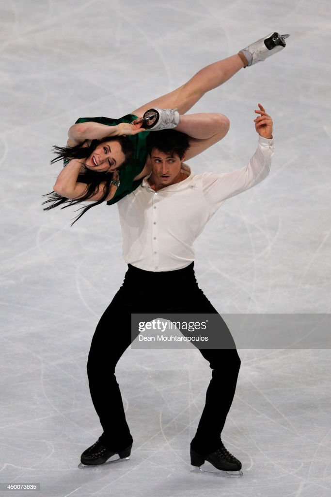 <a gi-track='captionPersonalityLinkClicked' href=/galleries/search?phrase=Tessa+Virtue&family=editorial&specificpeople=793314 ng-click='$event.stopPropagation()'>Tessa Virtue</a> and <a gi-track='captionPersonalityLinkClicked' href=/galleries/search?phrase=Scott+Moir&family=editorial&specificpeople=793313 ng-click='$event.stopPropagation()'>Scott Moir</a> of Canada perform in the Ice Dance Free Dance during day two of Trophee Eric Bompard ISU Grand Prix of Figure Skating 2013/2014 at the Palais Omnisports de Bercy on November 16, 2013 in Paris, France.