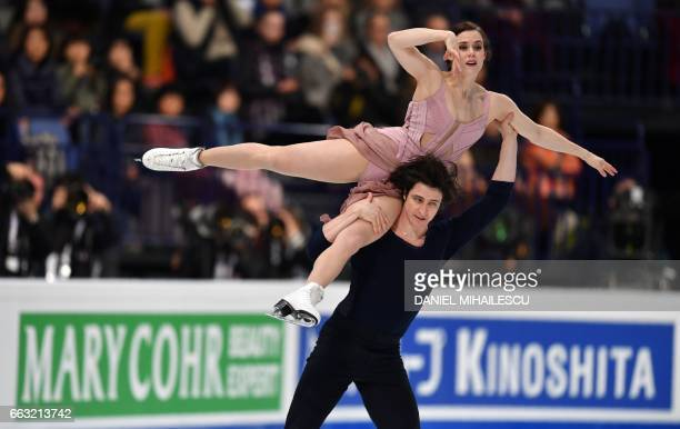 Tessa Virtue and Scott Moir of Canada perform their routine to win the Ice Dance / Free Dance event at the ISU World Figure Skating Championships in...