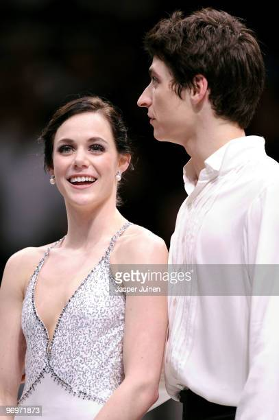 Tessa Virtue and Scott Moir of Canada pose after they won the Ice Dance competition on day 11 of the 2010 Vancouver Winter Olympics at Pacific...