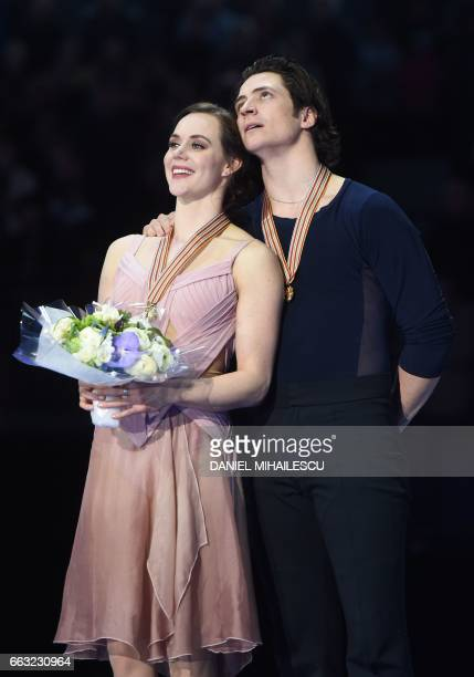 Tessa Virtue and Scott Moir of Canada pose after winning the Ice Dance / Free Dance event at the ISU World Figure Skating Championships in Helsinki...