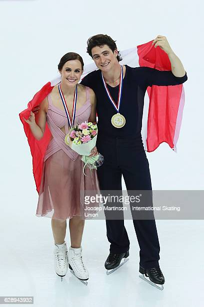 Tessa Virtue and Scott Moir of Canada pose during Senior Ice Dance Medal Ceremony on day three of the ISU Junior and Senior Grand Prix of Figure...