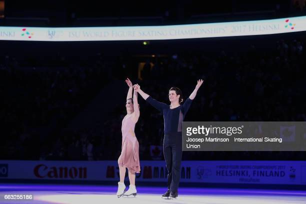 Tessa Virtue and Scott Moir of Canada pose in the Ice Dance medal ceremony during day four of the World Figure Skating Championships at Hartwall...