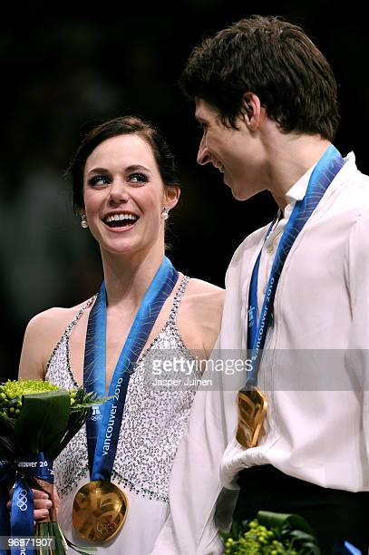 Tessa Virtue and Scott Moir of Canada pose with their gold medal after they won the Ice Dance competition on day 11 of the 2010 Vancouver Winter...