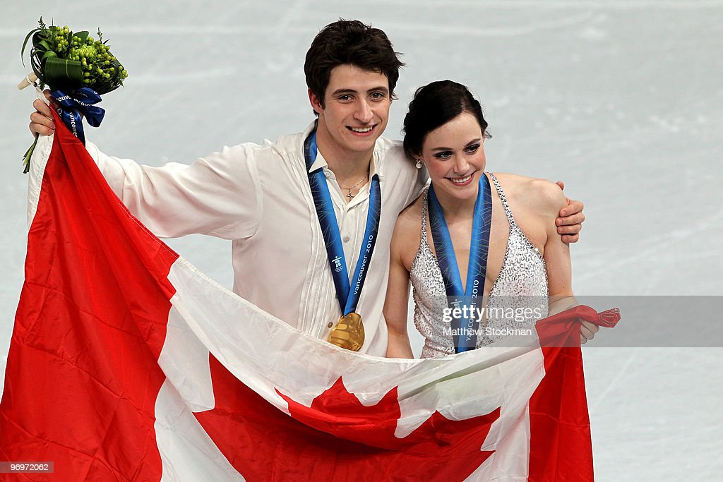 Tessa Virtue and Scott Moir of Canada pose with their gold medals after they won the Ice Dance competition on day 11 of the 2010 Vancouver Winter Olympics at Pacific Coliseum on February 22, 2010 in Vancouver, Canada. Tessa Virtue and Scott Moir of Canada won gold, Meryl Davies and Charlie White of USA won silver and Oksana Domnina and Maxim Shabalin of Russia won bronze.
