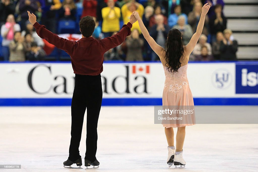 Tessa Virtue (R) and Scott Moir of Canada skate during the ice dance free program on day two at the ISU GP 2013 Skate Canada International at Harbour Station on October 26, 2013 in Saint John, New Brunswick, Canada.