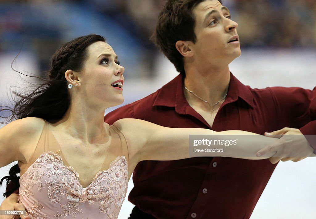 Tessa Virtue (L) and Scott Moir of Canada skate during the ice dance free program on day two at the ISU GP 2013 Skate Canada International at Harbour Station on October 26, 2013 in Saint John, New Brunswick, Canada.