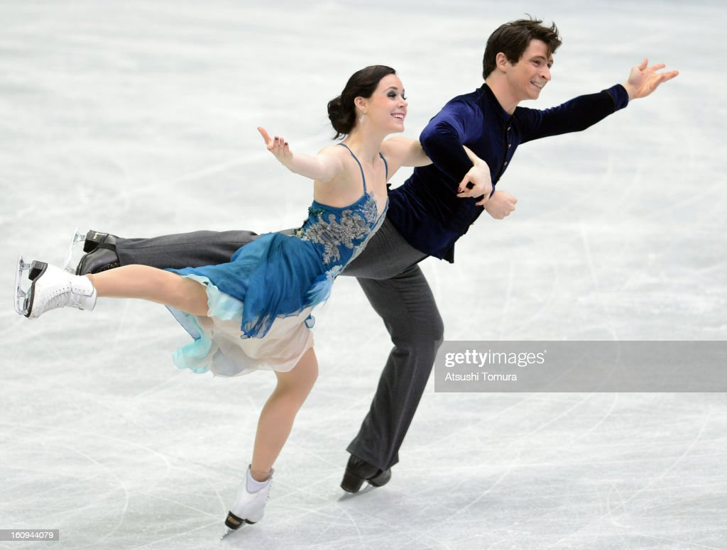 <a gi-track='captionPersonalityLinkClicked' href=/galleries/search?phrase=Tessa+Virtue&family=editorial&specificpeople=793314 ng-click='$event.stopPropagation()'>Tessa Virtue</a> and <a gi-track='captionPersonalityLinkClicked' href=/galleries/search?phrase=Scott+Moir&family=editorial&specificpeople=793313 ng-click='$event.stopPropagation()'>Scott Moir</a> of Canada skate in the Ice Dance Short Dance during day one of the ISU Four Continents Figure Skating Championships at Osaka Municipal Central Gymnasium on February 8, 2013 in Osaka, Japan.